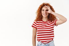 Everything perfect. Lucky upbeat enthusiastic redhead curly woman look through okay sign smiling delighted look. Satisfied approve good choice, agree like great royalty free stock photos