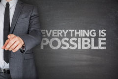Everything is possible on blackboard. With businessman Stock Photos