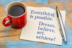 Everything is possible. Dream, believe, act, achieve!. A handwriting on a napkin with a cup of coffee Stock Photos