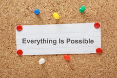 Everything Is Possible. The phrase Everything is possible typed on a piece of paper and pinned to a cork notice board stock photo