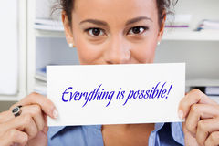 Everything is possible. Woman holding sign in hands Stock Photo