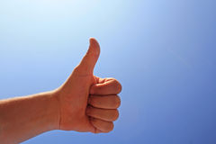 Everything in proper. Men's hand make thumbs up on blue sky Stock Photo