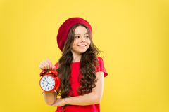 Everything is under control. Define own rhythm of life. Schedule and time. Set up alarm clock. Child little girl hold royalty free stock images