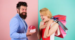 Everything she wants. Man bearded hipster hold gift box and girl enjoy shopping. Ask man to purchase lots presents for. Everything she wants. Man bearded hipster royalty free stock photography