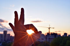 Everything will be fine - the sun inside the ok gesture Stock Images
