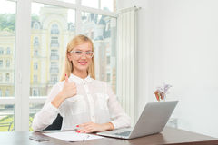 Everything is wonderful! Young businesswoman looking at the came Stock Image