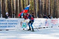 Evgeniy Garanichev (РУСЬ) на звезде 18 km людей биатлона мега массовой Стоковые Изображения