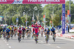 Evgeny Korolek from Belarus Crossing the Finish Line in Front of Peloton During International Road Cycling Competition Grand Prix Stock Photo