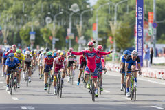 Evgeny Korolek from Belarus Crossing the Finish Line in Front of Peloton During International Road Cycling Competition Grand Prix Royalty Free Stock Photography