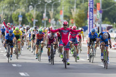 Evgeny Korolek from Belarus Crossing the Finish Line in Front of Peloton During International Road Cycling Competition Grand Prix Royalty Free Stock Photo