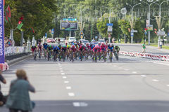 Evgeny Korolek from Belarus Crossing the Finish Line in Front of Peloton During International Road Cycling Competition Stock Photo