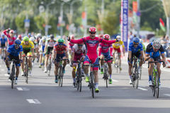 Evgeny Korolek from Belarus Crossing the Finish Line in Front of Peloton During International Road Cycling Competition Royalty Free Stock Image
