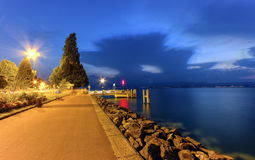 Evian-les-bains promenade near Geneva lake, France. Evian-les-bains promenade near Geneva lake at blue hour, France Stock Photography