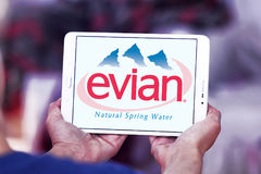Evian mineral water company logo. Logo of Evian mineral water company on samsung tablet Stock Image