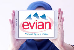 Evian mineral water company logo. Logo of Evian mineral water company on samsung tablet holded by arab muslim woman Royalty Free Stock Photography