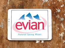 Evian mineral water company logo. Logo of evian mineral water company on samsung tablet on wooden background Royalty Free Stock Photography