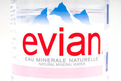 Evian Natural Spring Water. LONDON, UK - OCTOBER 13TH 2016: A close-up of the label on a bottle of Evian Natural Mineral Water - the brand is produced by Danone Royalty Free Stock Photography