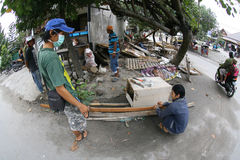 Evicted. Traders scavenge the rest of his stall after being evicted by government officials in the city of Solo, Central Java, Indonesia Stock Photo