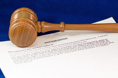 Eviction notice and gavel. A closeup detail of a legal notice of eviction and a wooden judge's gavel Royalty Free Stock Photography