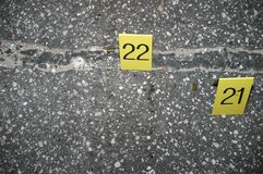 Evidence. Shell casings left on the road at the scene of a murder royalty free stock photos