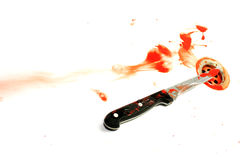 Evidence. A blood covered knife set in a whitebath with blood splatters surrounding. Blood being washed away down a plug hole Royalty Free Stock Images