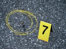 Evidence. 9mm spent shell casing located at the scene of the crime Royalty Free Stock Photography