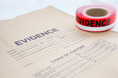 Evidence bag with evidence sealing tape  for crime scene. Evidence bag with red evidence sealing tape  for crime scene investigation Royalty Free Stock Photos