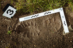 Evidence of footprint on crime scene Stock Images