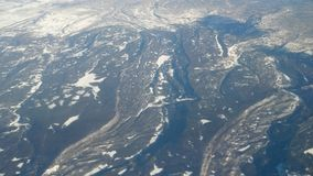 Evidence of Large Scale Geologic Activity. Appearing to be caused by massive amounts of water flow over a short period, seen from 35,000 feet AGL Stock Photography