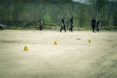 Evidence marke with blurred forensic and law enforcement background in cenematic tone. Evidence marker with blurred forensic and law enforcement team searching royalty free stock image
