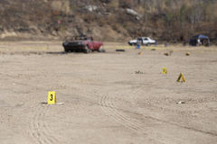 Evidence marker and blurred wrecked car with law enforcement background in post blast investigation training. With copy space royalty free stock images
