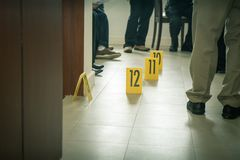 Evidence marker with law enforcement background. Evidence marker with law enforcement and forensic team background in cinematic tone royalty free stock photo