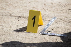Evidence marker and ruler scale of evidence with law enforcemen. T hand background stock photography