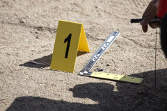 Evidence marker and ruler scale of evidence with law enforcemen. T hand background stock photos