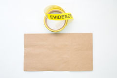 Evidence marker tape and paper bag in crime scene isolated on white background. Evidence marker tape and brown paper bag for crime scene isolated with blank and stock photo
