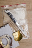 Evidence and marshal's character. Folding knife crime scene - evidence and marshal's character stock image