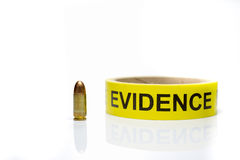 Evidence tape with 9 mm bullet on white background. Evidence tape with 9 mm bullet isolated on white background stock photos
