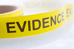 Evidence tape on white background. Yellow evidence tape on white background stock image