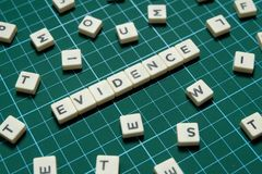 Evidence word made of square letter word on green square mat background. Evidence word made of square letter word on green square mat background royalty free stock photos