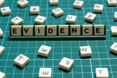 Evidence word made of square letter word on green square mat background. Evidence word made of square letter word on green square mat background royalty free stock photography