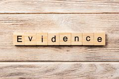 Evidence word written on wood block. evidence text on table, concept royalty free stock image