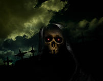 Evil. Skull on hook in front of crosses in cemetery Royalty Free Stock Photos