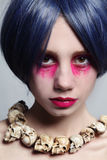 Evil angel. Portrait of young beautiful woman with fancy bright make-up and cosplay wig Royalty Free Stock Photography