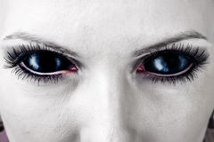 Evil black female zombie eyes. royalty free stock photos