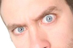 Evil Blue Eye #2 - Super Detail. Close up of a mans blue eyes. Extreme detail on and sharpness on left eye! (your right, my left Royalty Free Stock Photography