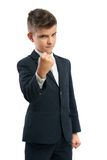 Evil boy showing his fist. Isolated Royalty Free Stock Photo