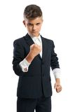 Evil boy showing his fist. Evil boy sleeves rolled up showing his fist isolated Royalty Free Stock Images