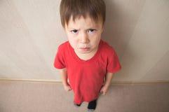 Evil boy underarm Royalty Free Stock Image