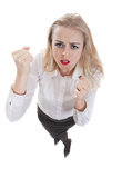 Evil business woman. Evil business women clasped her hands into fists, isolation on a white background Stock Image