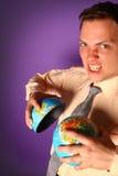 Evil businessman destroying the world Stock Photography
